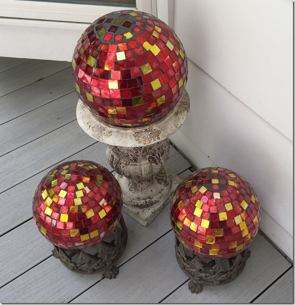 3 red mosaic gazing globes on deck