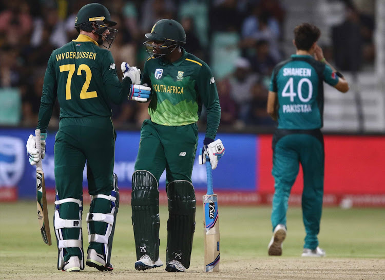 Andile Phehlukwayo with Rassie van der Dussen during the 2nd Momentum One Day International match between South Africa and Pakistan at Sahara Stadium Kingsmead on January 22, 2019 in Durban.