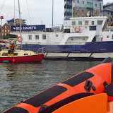 Nearly there - the ILB escorts the yacht into Poole Quay Boat Haven! 28 September 2013. Photo credit: RNLI / Dave Riley