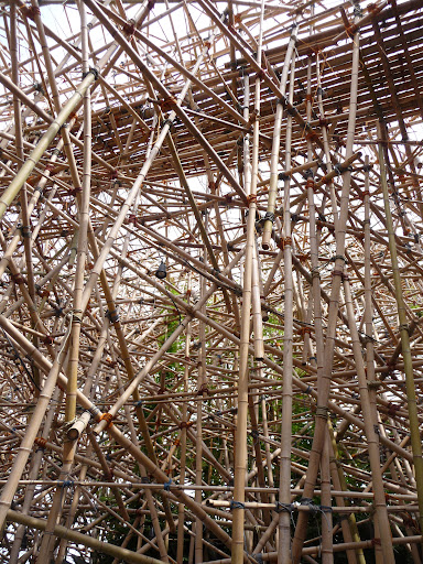 Can you believe this wild web of bamboo is sturdy enough to hold a group of people?