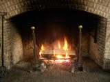 The Great Hall fireplace (burning 4-foot logs)