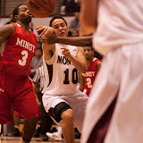 Sophomore guard Jordan Gregory passes in traffic to teammate Michael Weisner early in the first period of Wednesday's home game.  Dahlberg Arena in Missoula, Mont., November 14th, 2012.