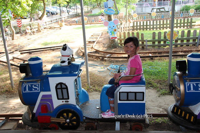 Tiger girl on a kiddy ride