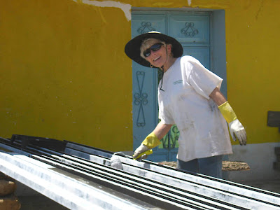 Caroline (Tom's mother) painting beams. Photos by TOM HART