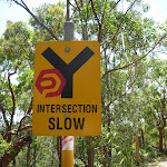 yellow sign showing 'Intersection Slow' near Murray's beach (389018)