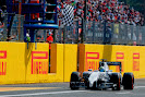 Felipe Massa, Williams FW36 Mercedes, takes the chequered flag for a podium finish