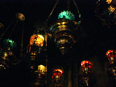 Lamps in the tomb chamber in the Church of the Holy Sepulchre on Good Friday in Jerusalem Israel