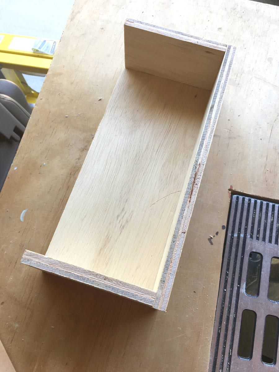 Plywood cabinet riser organizer