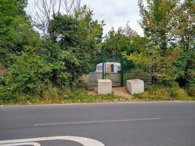 Fence starting from railway bridge