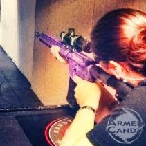 Lisa Marie Judy, woman shooting purple rifle