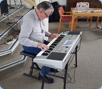 Roy Steen playing his Korg Pa80 arranger keyboard.