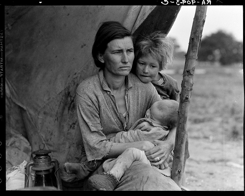 Migrant agricultural worker's family. Seven hungry children. Mother aged thirty-two. Father is a native Californian. Destitute in pea picker's camp, Nipomo, California, because of the failure of the early pea crop. These people had just sold their tent in order to buy food. Of the twenty-five hundred people in this camp most of them were destitute, March 1936. (Dorthea Lange/Library of Congress/LC-USF34-T01-009093)