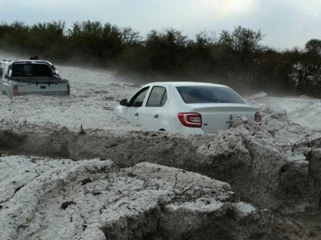 Cars drive through the debris of a hailstorm in Argentina that dumped almost five feet of hailstones in minutes, 28 October 2017. Photo: SMN Argentina