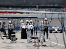 Rubens Barrichello, Honda RA106 approaches as his team wait to perform a pitstop