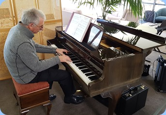 Claude Moffat playing the Village's Schimmel mini-grand piano