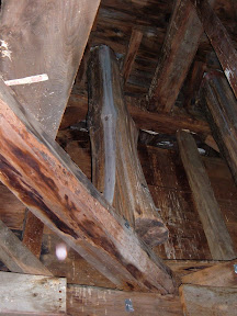 The posts that make up the octogon were made from butternut trees.  The columns were smooth and round above the bell deck but left whole below.