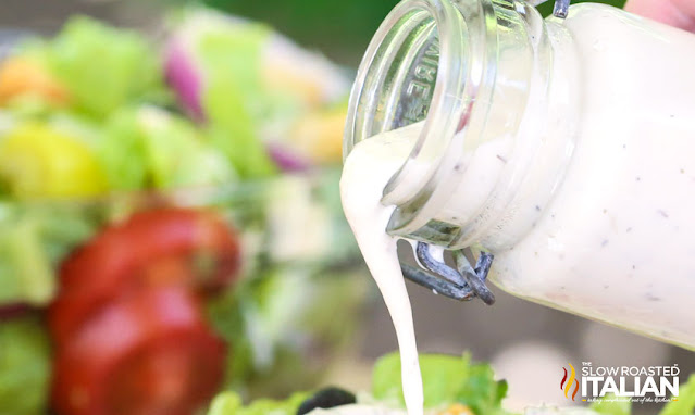 homemade salad dressing recipe pouring out of a bottle