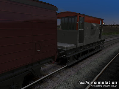 Fastline Simulation: Dia 1/507 20T brake van in Railfright livery with lit side lamp showing the white front aspect.