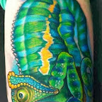Green Lizard - arm tattoo