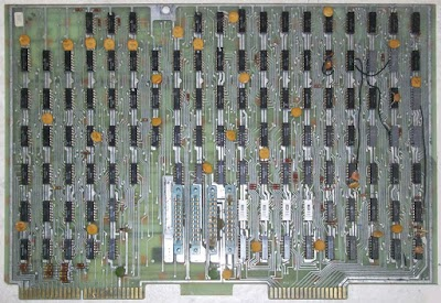 The CPU of the Datapoint 2200 computer was built from a board full of TTL chips. The four white chips in the lower center-right are Intel 3101 RAM chips holding the stack. Photo courtesy of Austin Roche (I think).