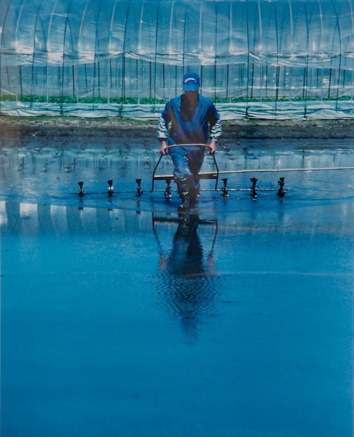 黄倉良二さん、若き頃の農作業風景