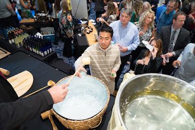 Sake flowing from barrels at Sake Fest 2014. Image courtesy of 750 Media