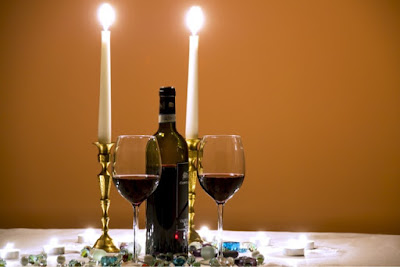 Candles, wine bottle and glasses