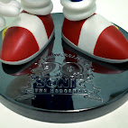Figure tray with 20th anniversary logo