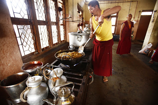 Many monks help prepare the daily meals.