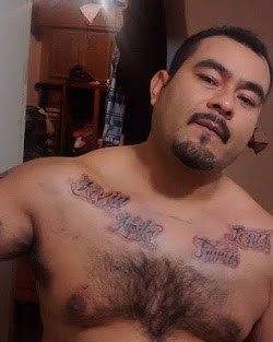 Chuy showing off his tattoos.