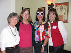 Beverly Gill, Susan Gebren, Cari Perlingiero and Joan Meacher show they give a hoot at the Chi Omega Christmas party in Grapevine.