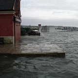 Flooding at high tide and with a westerly gale - Easter 2008 - with the fishermans' harbour in the background