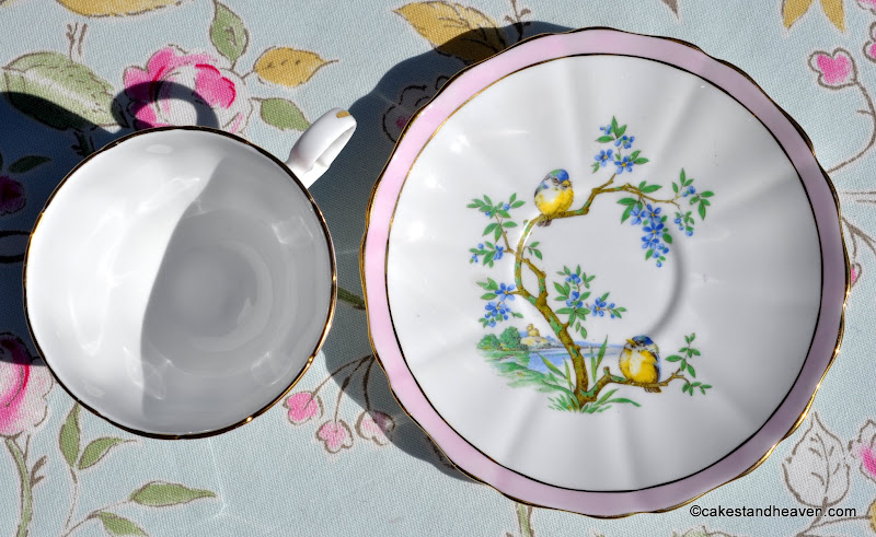 Scallop rimmed china with pastel pink border