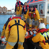 The casualty is transferred from the tug onto the quayside on a stretcher - Training exercise, 19 February 2012