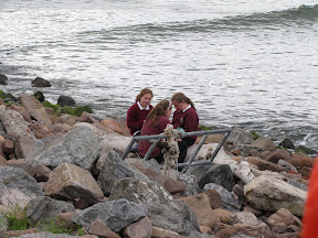 schoolgirls gossiping on the rocks, because humans are the same wherever you go