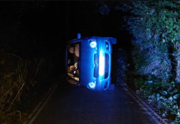 Police rescue couple having sex in a car after it rolled down the hill and flipped when they knocked the handbrake