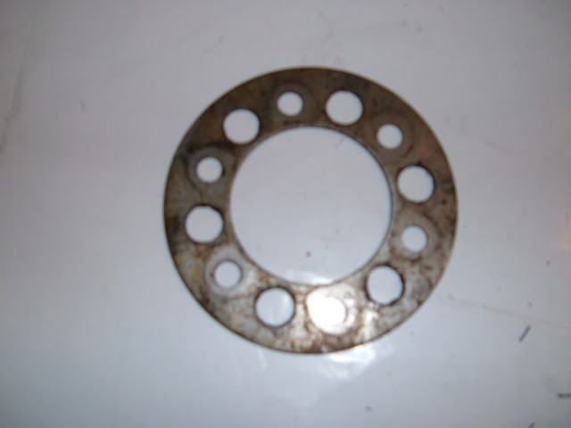 Pulley plate, they started using these in 1957 and most engines after that. 15.00 each used.