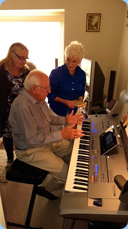 Our host, Rob Powell, playing his Yamaha Tyros 5 (76 note version) with Desiree Barrows and Audrey Henden watching-on.