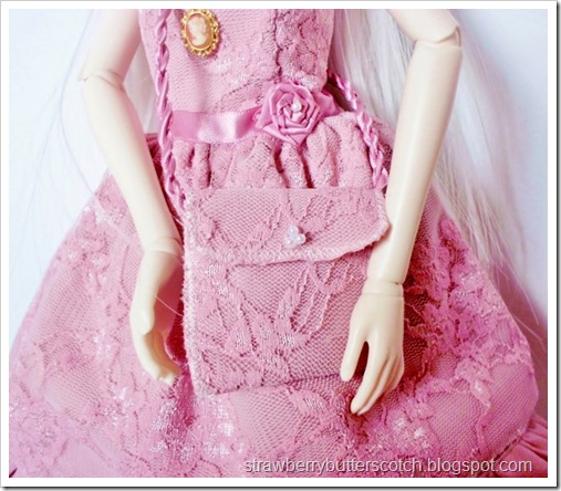 Pink lace purse for a doll.