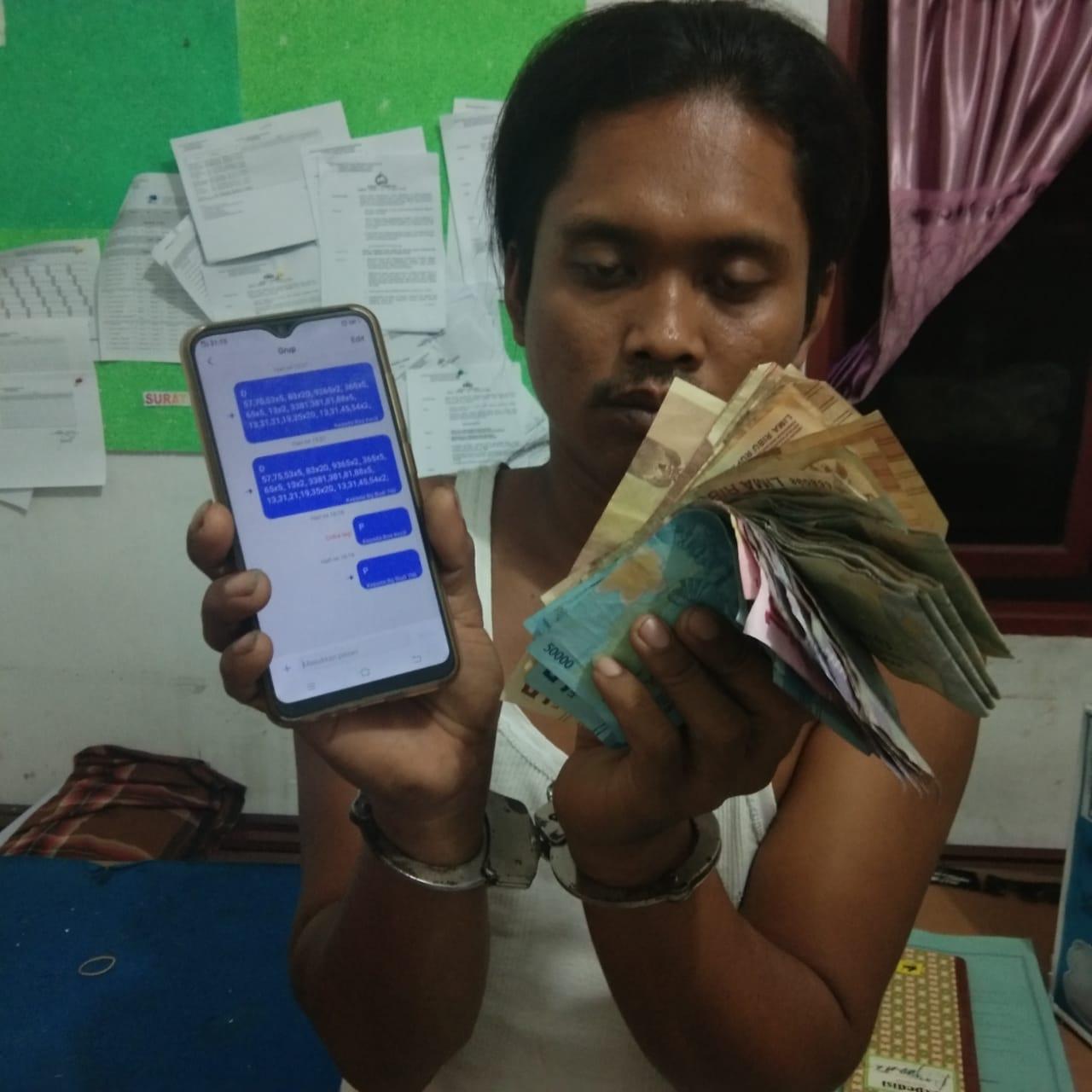 Jual Togel, Si Gondrong ditangkap Tim Opsnal Reskrim Polsek Dolok Masihul