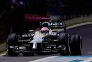 Jenson Button enters the pit lane with his McLaren MP4-29