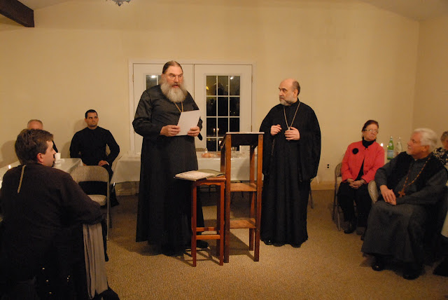 Fr. Daniel Degyansky, secretary of the Deanery, assists in presenting gramotas (citations) to the benefactors.