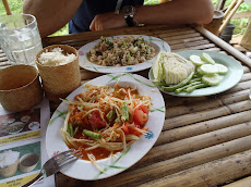 One of our favourite meals- at the street cafe near our bungalow. Papaya salad and chicken salad- 110B!! ($3)