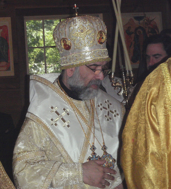 Vladyka takes the trikiri and dikiri (the episcopal candle branches).