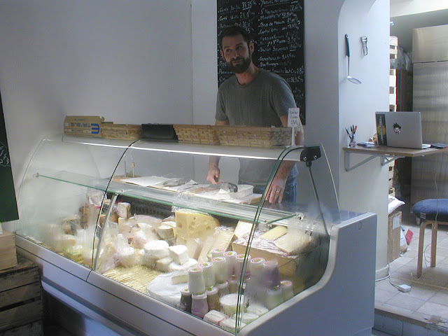 Cheese counter in a grocery store, Indre et Loire, France. Photo by Loire Valley Time Travel.