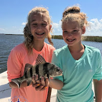 Samantha and Abbie with a small black drum 10-06-2018
