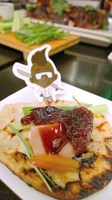 Departure Peking Duck - carved by the kitchen and served with pickled kumquats and for the DIY pancakes with duck fat mandarin pancakes in a steamer to keep it warm. The accompanmients include little dishes of cucumbers, sliced scallions, house made plum and hoisin sauces to make your own mini wraps with all these ingredients