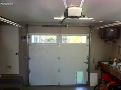 Daily Dose Of Doors Garage Door With A Doggy Door Installed