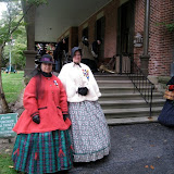 The ladies grace the steps of the veranda of President Hayes home as the 5th MI prepares to play for Sunday Church Service
