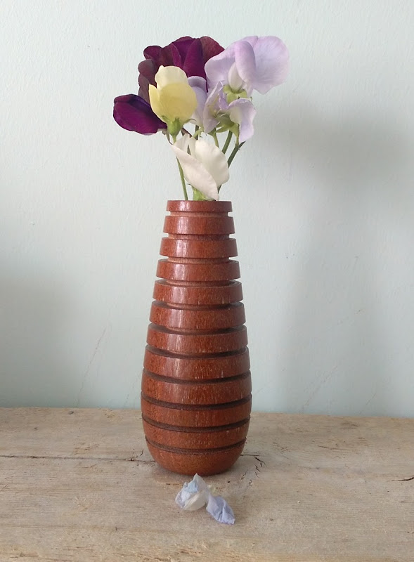 wood stick vase and sweet peas